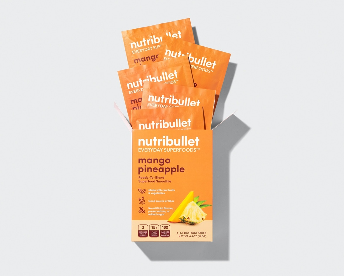 Product preview 4 of 6. Thumbnail five NutriBullet mango pineapple superfood packets coming out of orange box with mango and pineapple image.