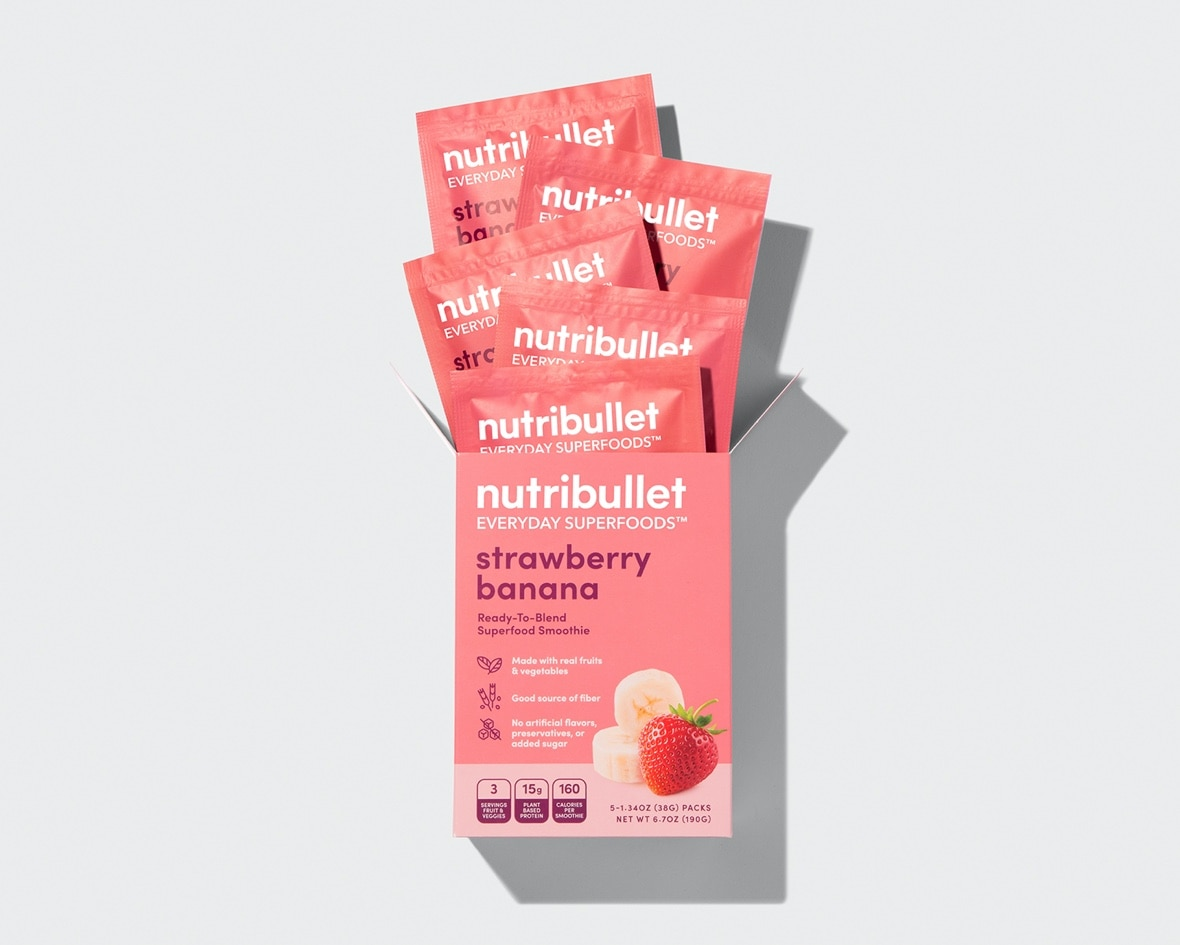 Product preview 4 of 6. Thumbnail five NutriBullet strawberry banana superfood packets coming out of pink box with strawberry and banana image.