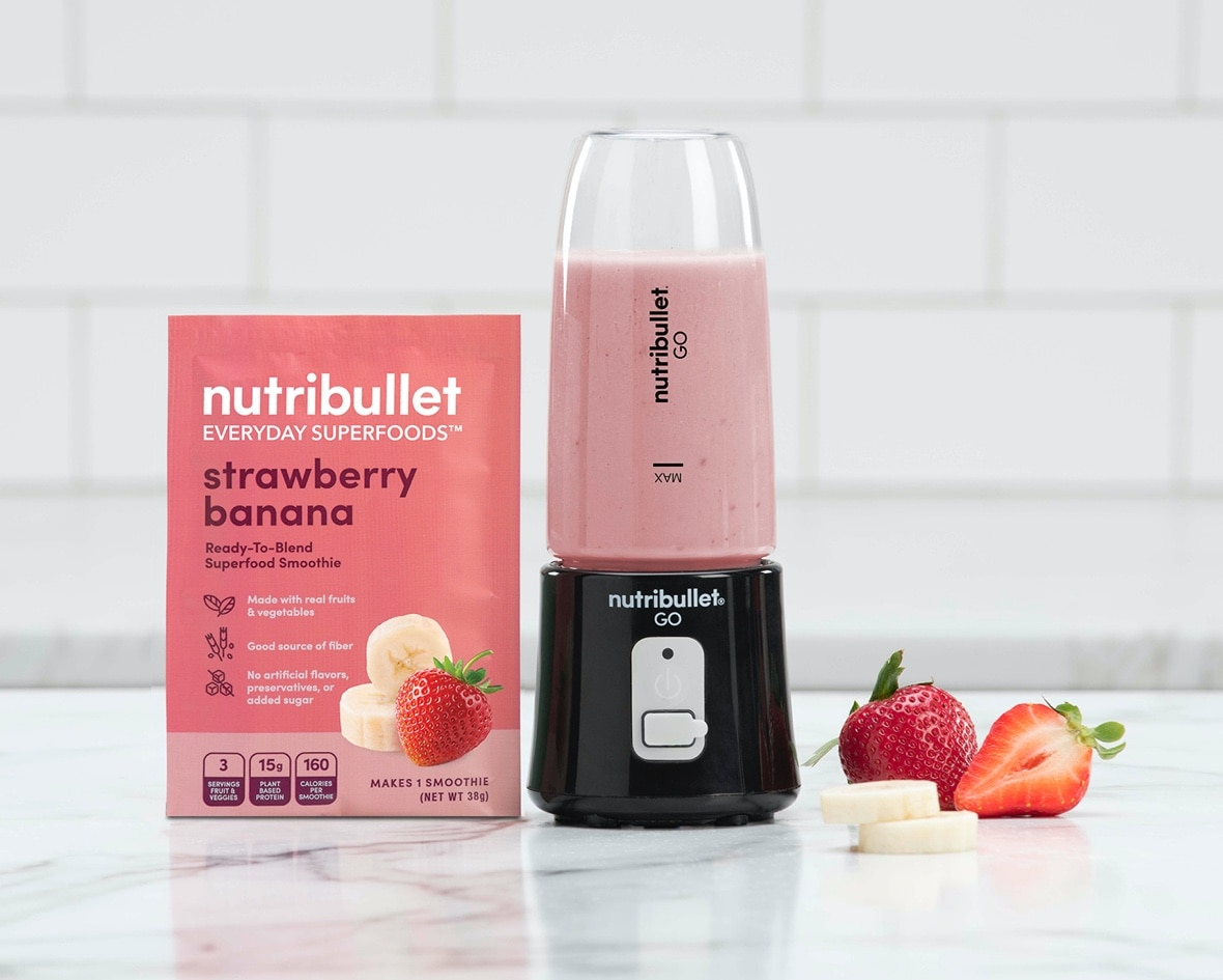 Product preview 6 of 6. Thumbnail NutriBullet strawberry banana pink packet with strawberry and banana image and NutriBullet GO filled with smoothie.